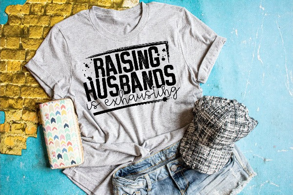 "(1) Short sleeve shirt ""Raising Husbands Is Exhausting"" (accessories in the photo are not included)."