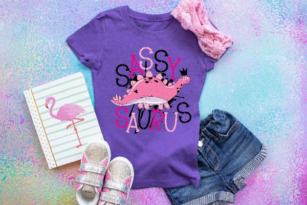 "(1) Short sleeve shirt ""Sassysauras - Youth Shirt"" (accessories in the photo are not included)."