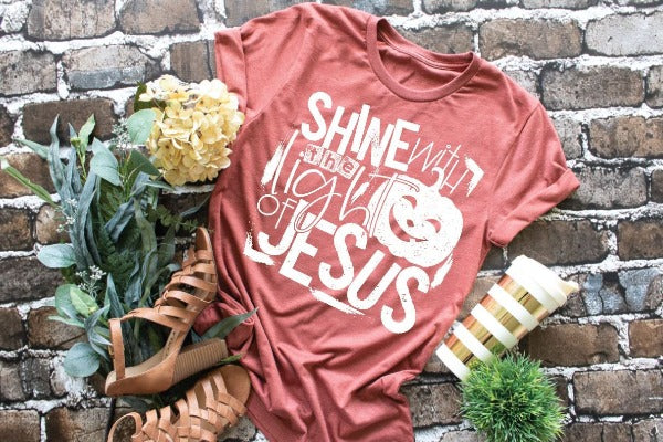 "(1) Short sleeve shirt ""Shine With The Light Of Jesus - Youth Shirt"" (accessories in the photo are not included)."