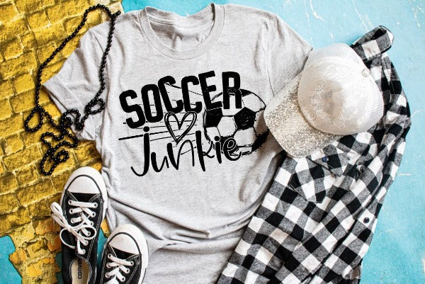 "(1) Short sleeve shirt ""Soccer Junkie"" (accessories in the photo are not included)."