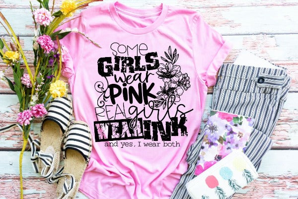 "(1) Short sleeve shirt ""Some Girls Wear Pink Real Girls Wear Ink (And Yes I Wear Both)"" (accessories in the photo are not included)."