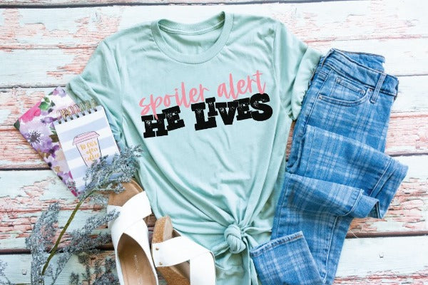 "(1) Short sleeve shirt ""Spoiler Alert He Lives"" (accessories in the photo are not included)."