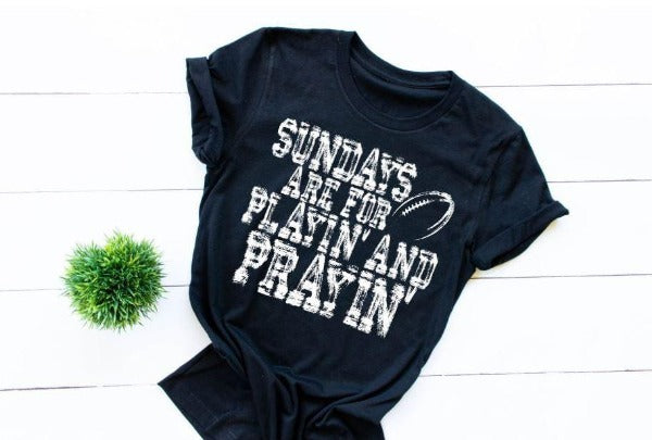 "(1) Short sleeve shirt ""Sundays Are For Playin' And Prayin'"" (accessories in the photo are not included)"