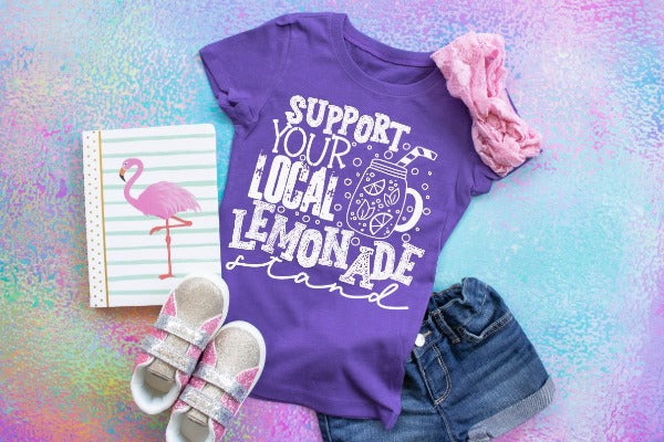 "(1) Short sleeve shirt ""Support Your Local Lemonade Stand - Youth Shirt"" (accessories in the photo are not included)."