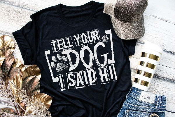 "(1) Short sleeve shirt ""Tell Your Dog I Said Hi"" (accessories in the photo are not included)."