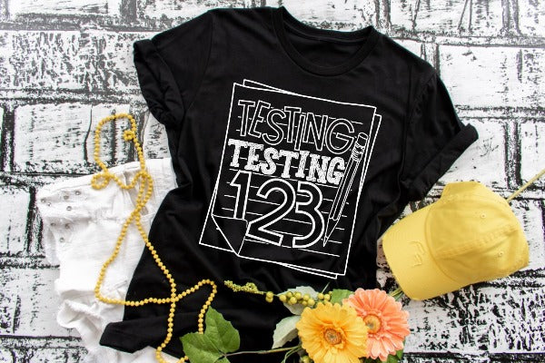 "(1) Short sleeve shirt ""Testing Testing 123"" (accessories in the photo are not included)."