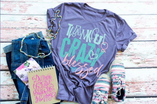 "(1) Short sleeve shirt ""Thankful And Crazy Blessed"" (accessories in the photo are not included)"