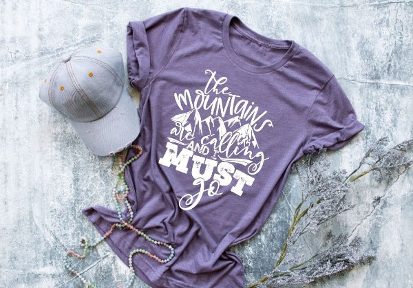 "(1) Short sleeve shirt ""The Mountains Are Calling And I Must Go"" (accessories in the photo are not included)."