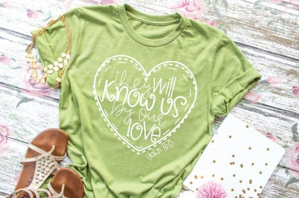 "Short sleeve shirt ""They Will Know Us By Our Love"" (accessories in the photo are not included)."