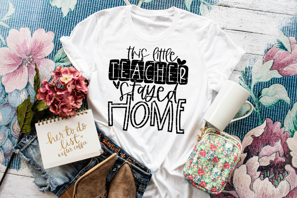 "(1) Short sleeve shirt  ""This Little Teacher Stayed Home"" (accessories in the photo are not included)"