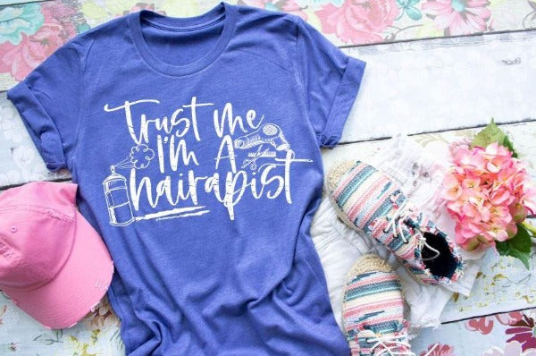 "1) Short sleeve shirt ""Trust Me I'm A Hairapist"" (accessories in the photo are not included)"