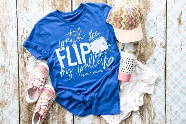 "(1) Short sleeve shirt ""Watch Me Flip My Wallet-Gymnastics Mom"" (accessories in the photo are not included)."