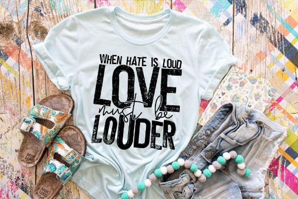 "(1) Short sleeve shirt ""When Hate Is Loud Love Must Be Louder"" (accessories in the photo are not included)"
