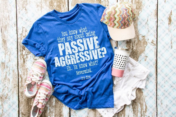 "(1) Short sleeve shirt ""You Know What They Say About Being Passive Aggressive? Eh. You Know What? Nevermind. It's fine."" (accessories in the photo are not included)."