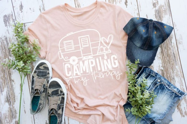 "(1) Short sleeve shirt ""Camping Is My Therapy"" (accessories in the photo are not included)."