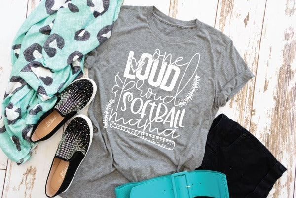 "(1) Short sleeve shirt ""One Loud And Proud Softball Mama"" (accessories in the photo are not included)."
