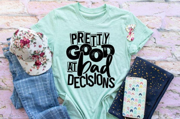 "(1) Short sleeve shirt ""Pretty Good At Bad Decisions"" (accessories in the photo are not included)."