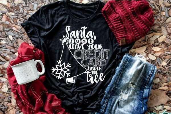 "(1) Short sleeve shirt ""Santa Just Leave Your Credit Card Under The Tree"" (accessories in the photo are not included)."