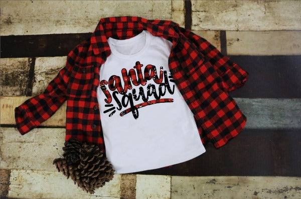 "(1) White short sleeve shirt ""Santa Squad - Youth Shirt"" (accessories in the photo are not included)."