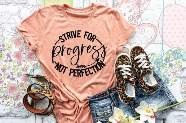 "(1) Short sleeve shirt ""Strive For Progress Not Perfection"" (accessories in the photo are not included)."