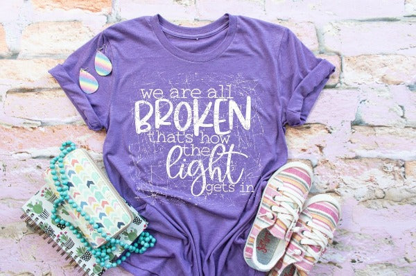 "(1) Short sleeve shirt ""We Are All Broken That's How The Light Gets In"" (accessories in the photo are not included)"