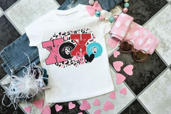 "(1) Short sleeve shirt ""XOXO- Toddler Shirt"" (accessories in the photo are not included)."