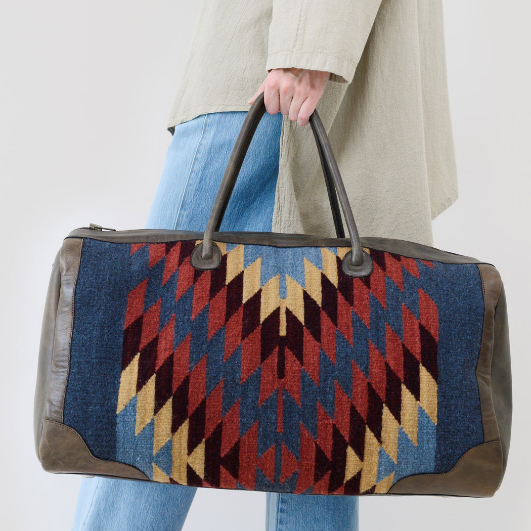 Brown Leather Duffel Bag With Woven Panels Of Zapotec Diamond Designs In Red, Blue, And Yellow