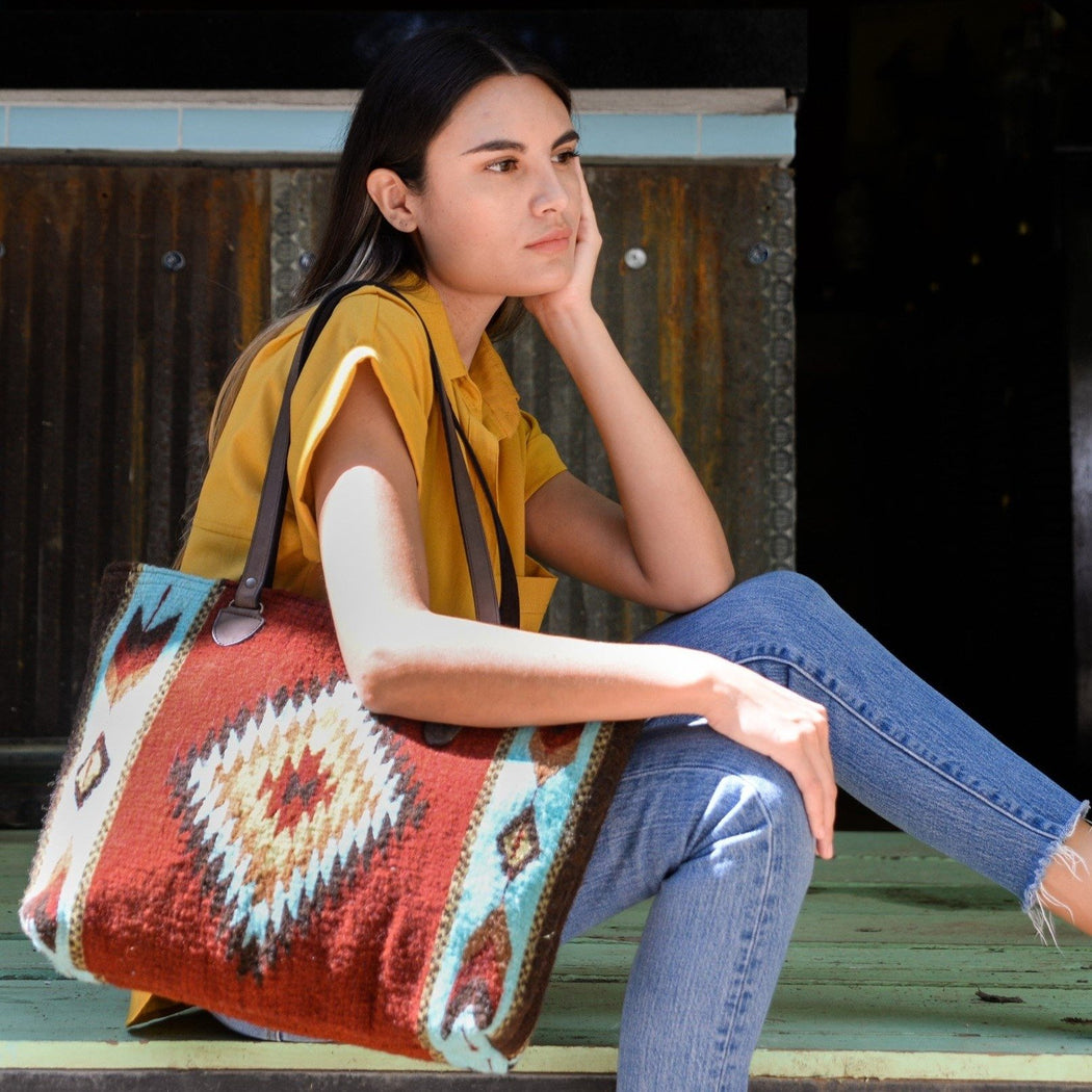 Woman With Brick Red Wool Tote Bag With Zapotec Diamond & Arrow Designs And Brown Leather Strap