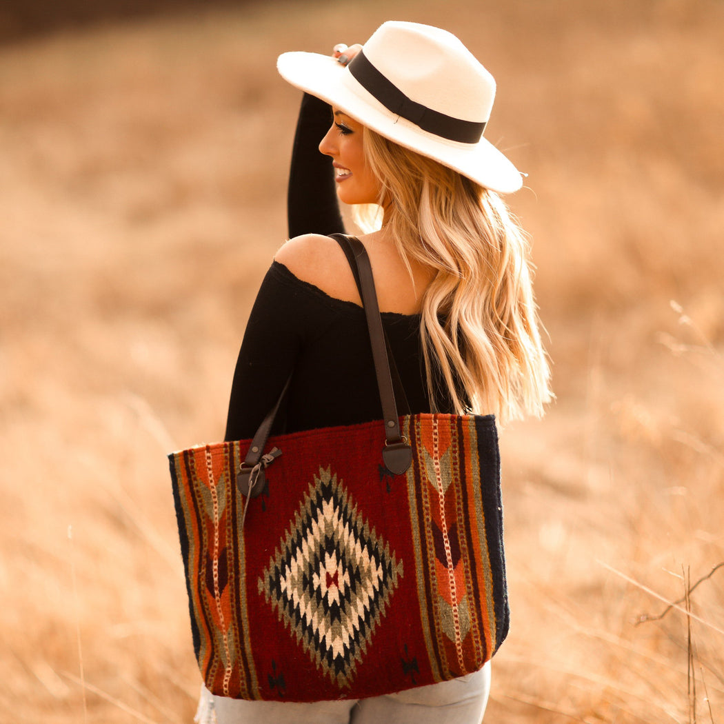 Woman Wearing Red Wool Tote Bag With Multicolored Zapotec Diamonds & Arrows Design With Brown Leather Straps