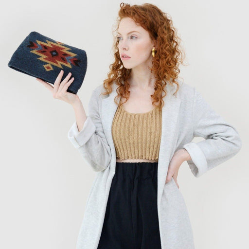 Woman Holding Blue Wool Clutch With Zapotec Diamond Design In Red And Yellow
