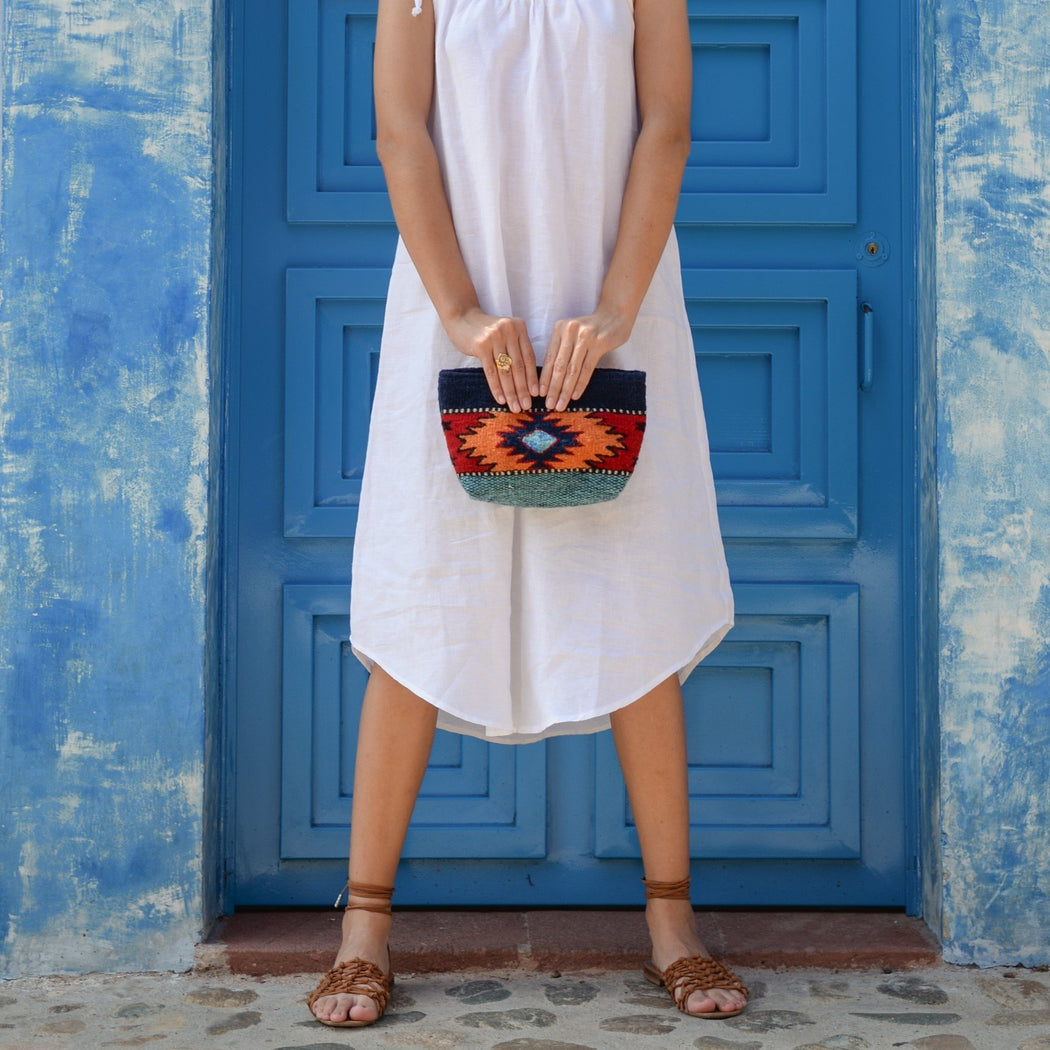 Model With Blue Wool Clutch Purse With Zapotec Diamond & Butterfly Design In Orange And Red