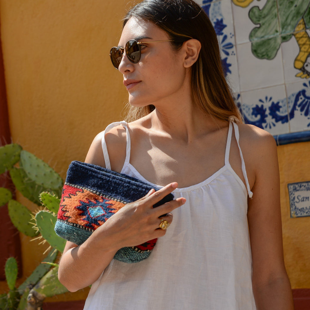 Woman With Blue Wool Clutch Purse With Zapotec Diamond & Butterfly Design In Orange And Red