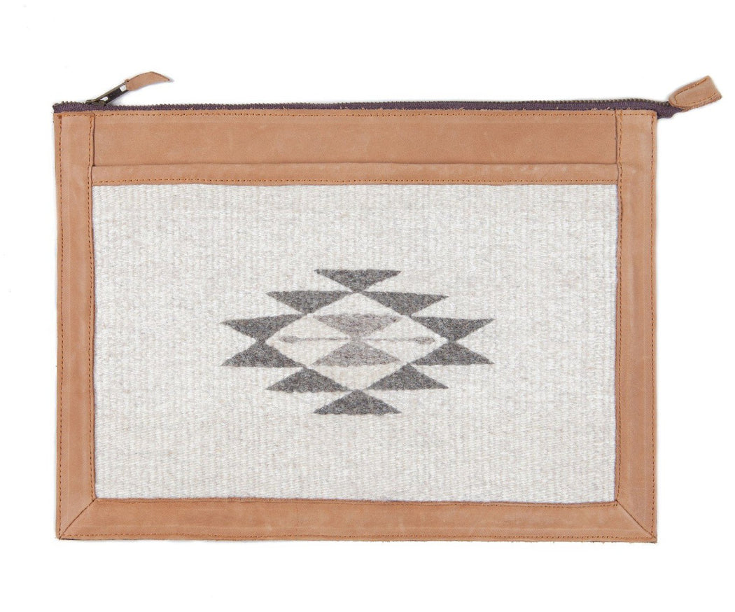 Detail View Of Blonde Leather Laptop Sleeve With Zapotec Diamond & Butterfly Designs In Undyed Wool