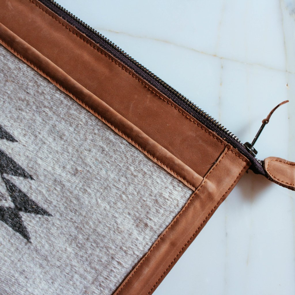 Zipper Detail View Of Blonde Leather Laptop Sleeve With Zapotec Diamond & Butterfly Designs In Undyed Wool