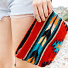 Woman Carrying Red Wool Clutch Purse With Zapotec Arrow Designs In Blue, Yellow, Burgundy, Orange & Tan With Leather Strap