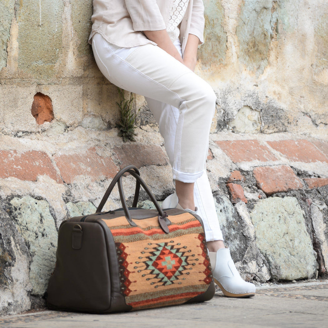 Brown Leather Duffel Bag With Zapotec Diamond & Agave Design In Robin's Egg Blue, Coral And Brick Red, On Beige Wool With Adjustable Leather Strap