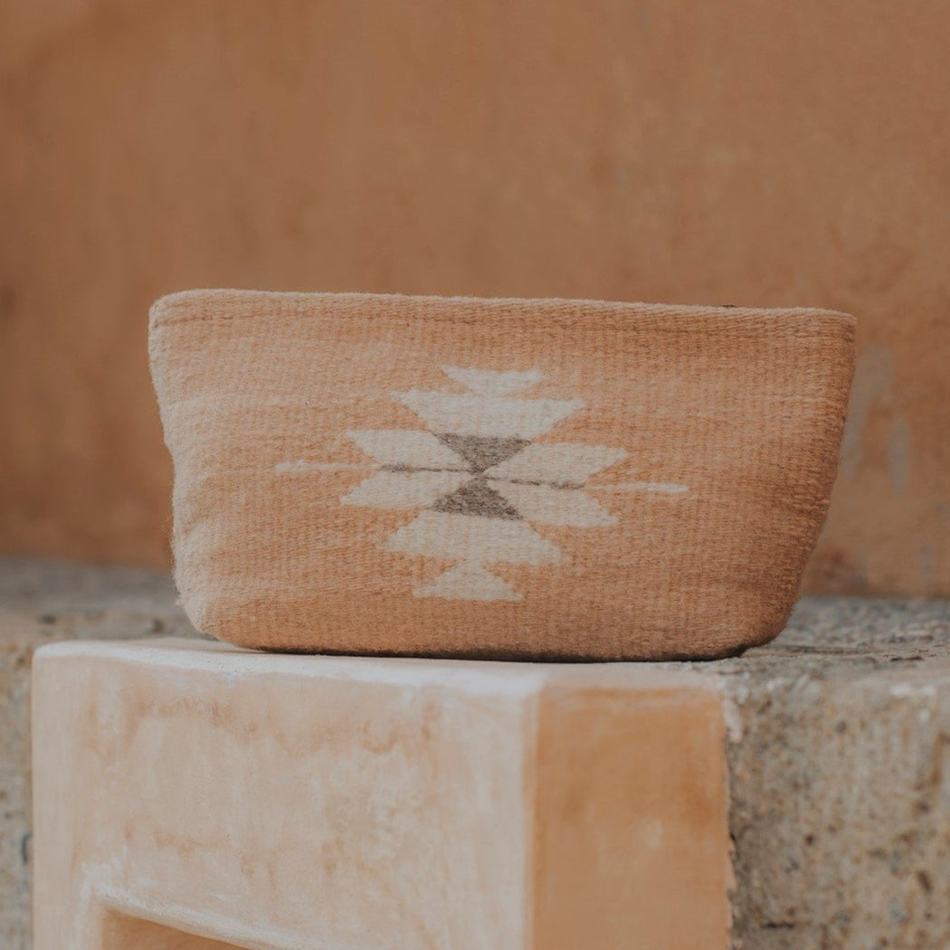 Close Up Of Wool Clutch Purse Featuring Zapotec Diamond Design In Soft Cream On Pink On Granite Step