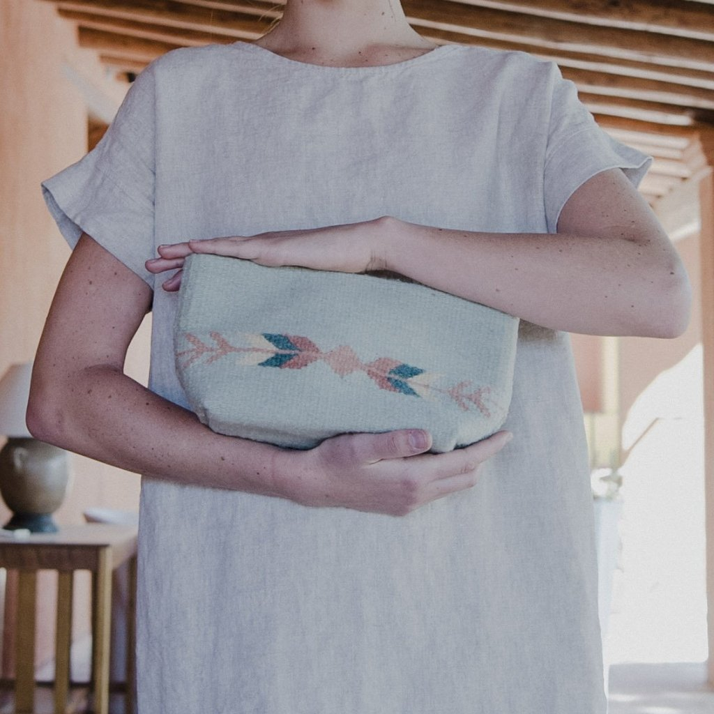 Woman Holding Mint Green Wool Clutch Bag Featuring Zapotec Arrow Design
