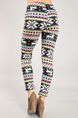 back of women from waist down wearing black, pink, & blue brightly colored Christmas leggings with reindeer
