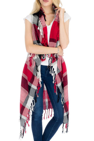 Front view of women wearing burgundy plaid vest with fringe