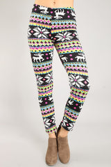 front of women from waist down wearing black, pink, & blue brightly colored Christmas leggings with reindeer
