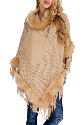 Women wearing beige embossed poncho with faux fur neckline and hem with trim