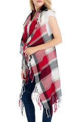 Side view of women wearing burgundy plaid vest with fringe
