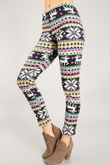 side view of women from waist down wearing black, pink, & blue brightly colored Christmas leggings with reindeer