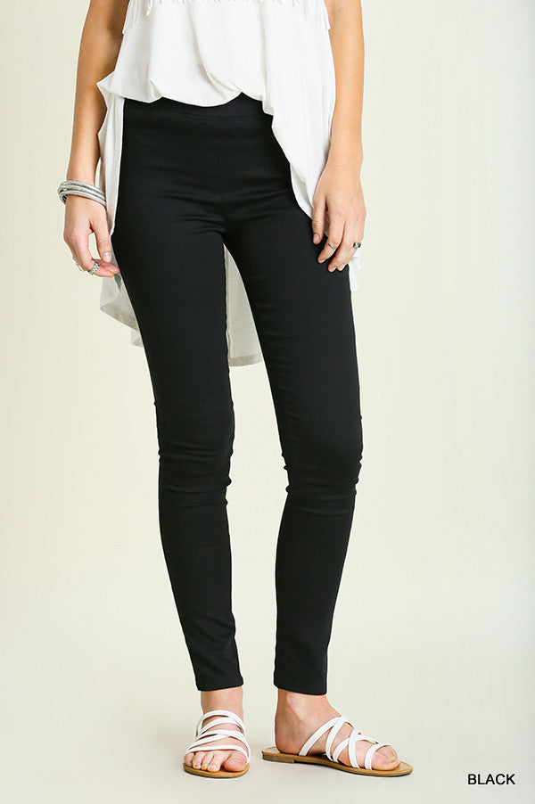 front view of woman from waist down wearing black jeggings