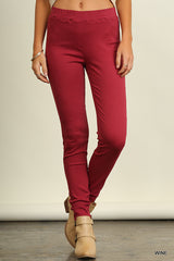 front view of woman from waist down wearing wine jeggings