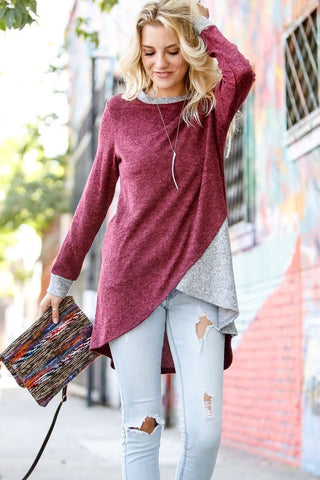 Front view of women wearing wine and contrasting grey high low long sleeve tunic top
