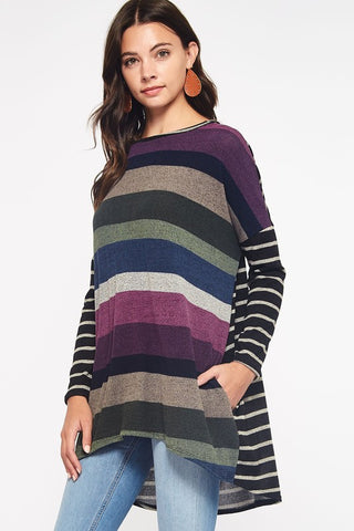 Close up front view of woman wearing hi/low striped tunic with contrasting sleeves and back