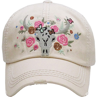 Beige Baseball cap with grey bull skull and embroidered flowers in pink, blues, browns surrounding it