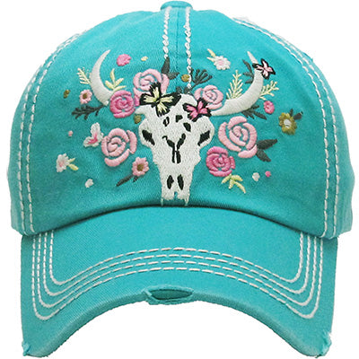 Turquoise Baseball cap with white bull skull and embroidered flowers in dark pink, light pink & white surrounding it